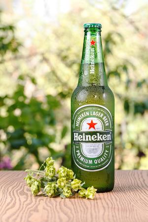 Heineken Lager Beer bottle on wooden background. UKRAINE - September 10, 2016