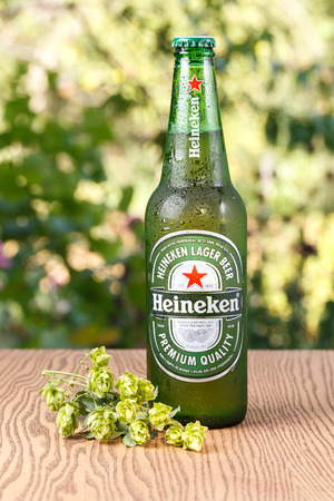 Heineken Lager Beer bottle on wooden background. UKRAINE - September 10, 2016