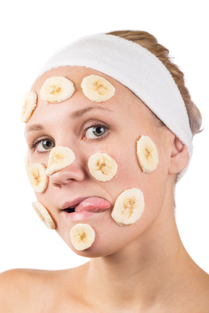 A young girl makes a face mask. Stock Photo