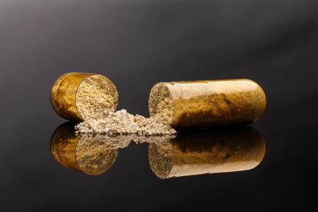 Photo of medical pills on black background.