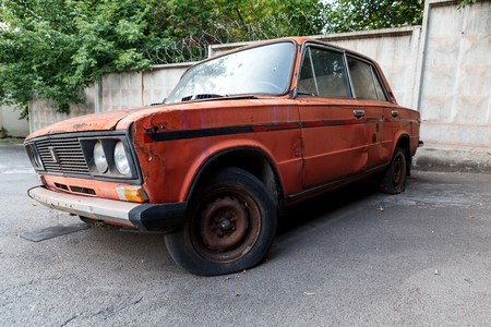 KRIVOY ROG, UKRAINE - JUL 16 - The old, abandoned car VAZ 2106 is out of order, Sunday 16 July 2017