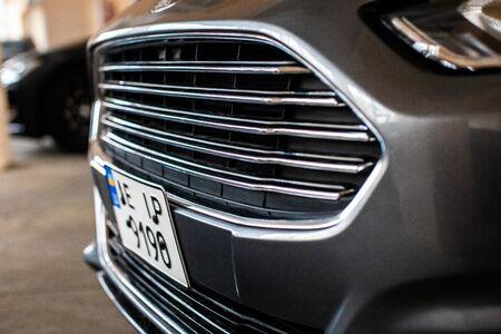 KRIVOY ROG, UKRAINE - DECEMBER 08, 2019: Photo of black Ford Fusion Titanium in covered parking.
