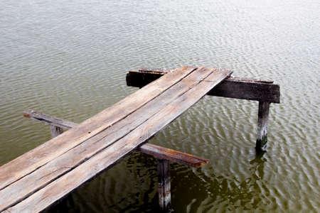 seawater: Wood bridge at an ocean. Stock Photo