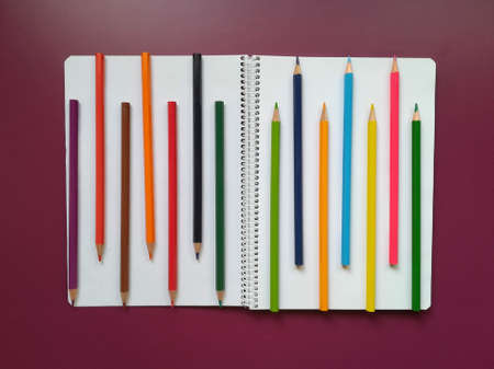 Various school material in composition on purple background