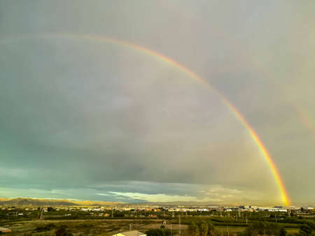 View of two rainbow media on a cloudy day Stok Fotoğraf - 122064158