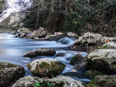 Palancia river waters flowing through the rocks in long exposure Banco de Imagens