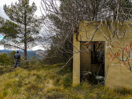 Abandoned house invaded by nature on the mountain