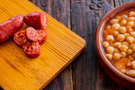 Chickpea dish and ingredients in composition on wooden background Stock fotó