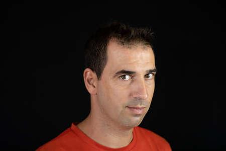 Portrait of man on a black background Imagens - 128789728