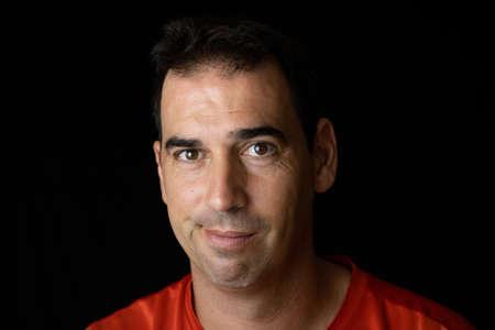 Portrait of man on a black background Imagens - 128789813