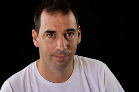 Portrait of man on a black background Imagens