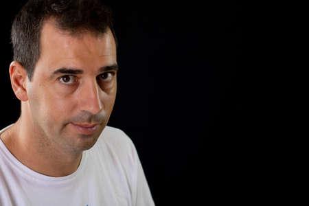 Portrait of man on a black background Imagens - 128789981
