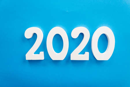2020 number written in white on blue background, new year concept