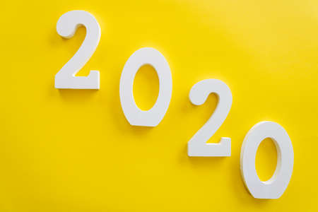 2020 number written in white on yellow background, new year concept
