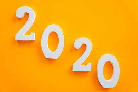 2020 number written in white on orange background, new year concept Imagens