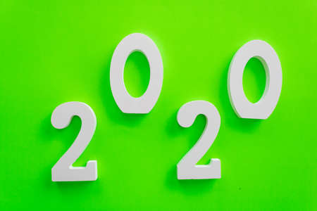 2020 number written in white on green background, new year concept