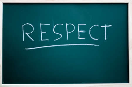 Respect written on a blackboard with white chalk Imagens