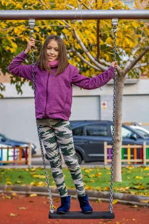 Little girl posing in the village park
