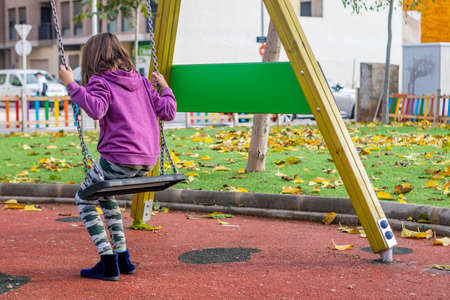 Little girl playing in the village park