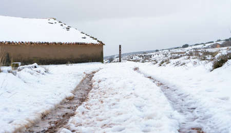 Old snowy houses in the town of Barracas