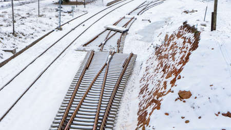 Snowy train tracks in the town of Barracas
