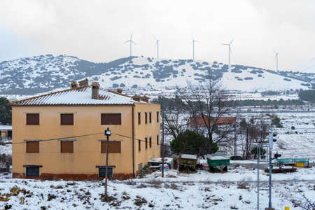 View of the snowy mountains with the electric mills in Barracas