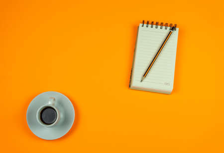 Cup of coffee isolated on orange background Stockfoto