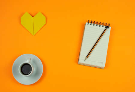 Cup of coffee isolated on orange background, love concept