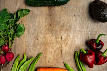 Fresh vegetables in composition on old wooden background. Healthy concept Stockfoto