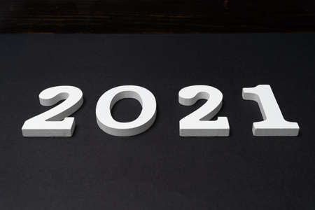 Conceptual image of the arrival of a 2021 represented in white on a black background. Hope concept