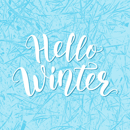 Hello winter. Hand lettering quote logo with frozen texture. Brush calligraphy. Calligraphic design for invitation, greeting card, t-shirt, prints and posters. Vector illustration. Blue color.