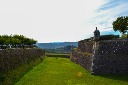 Views of a small town and vegetation, trees and mountains from the walls of Valença, Portugal