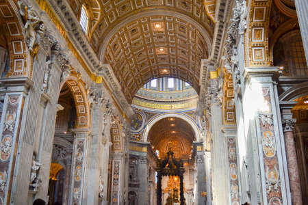 Inside of St. Peters Basilica in Vatican City, Italy, with St. Peters Baldachin (Baldacchino di San Pietro, LAltare di Bernini) in the background.