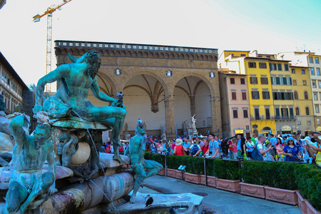 Fountain of Neptune (Fontana del Nettuno) in Piazza della Signora with a lot of people in front of it. Florence, Italy.