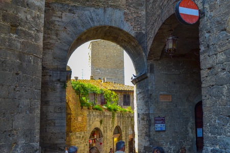 Arch of a door with forbidden signal to passage in oldtown of San Gimignano, Italy.