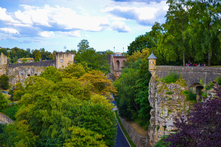 Wall of old town of Luxembourg City, Luxembourg, with green trees
