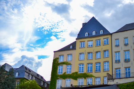 Typical colorful houses of Luxembourg, Europe, with a cloudy sky at the background
