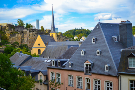 View of the old town of Luxembourg City, Luxembourg, with St. John Church (church of St. John or St. Jean du Grund) and the wall in the background Stock Photo