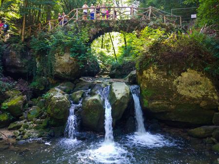 Schiessentümpel or Schéissendëmpel Waterfall in Mullerthal, Luxembourg. Stock Photo - 122059753