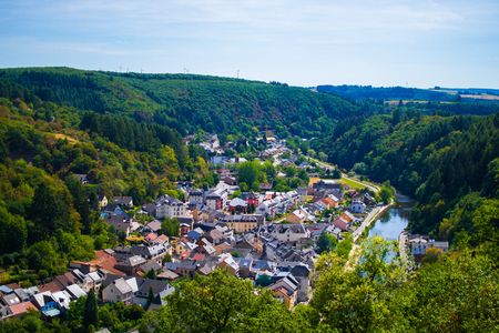View of the village and valley of Vianden, with mountains and forest, and the Our river crossing, in Luxembourg, Europe Standard-Bild
