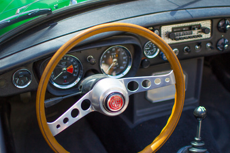 Vianden, Luxembourg; 08/12/2018: view of the steering wheel and speedometer in the interior of a MG MGB, a vintage old classic sport car