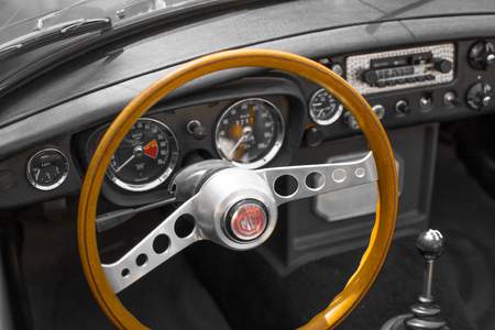 Vianden, Luxembourg; 08122018: view of the steering wheel and speedometer in the interior of a MG MGB, a vintage old classic sport car
