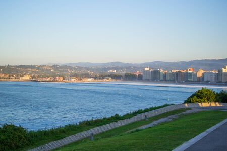 View of Gijon and Cantabrian Sea from Cerro de Santa Catalina, in Asturias, Spain. Green park and hill 스톡 콘텐츠