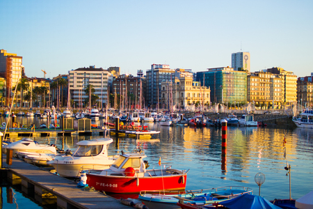 Gijon, Asturias, Spain; 09/26/2018: View of the dock of Gijon, Asturias, Spain, with reflections in the water, in Cimadevilla, the old town, during the sunset. Peaceful place