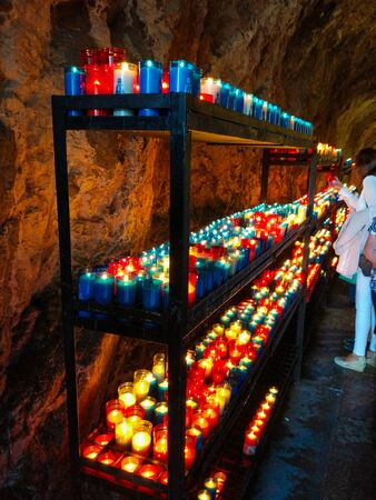A lot of colorful candles glowing in Covadonga, Asturias, Spain. Religious symbol of the spanish reconquest by King Pelayo
