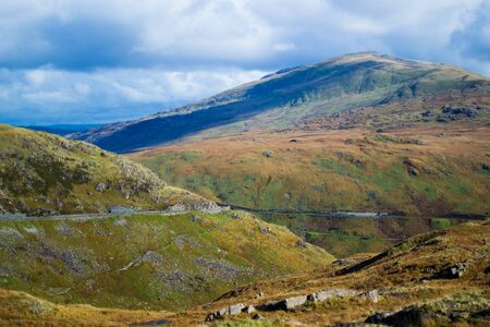 Landscape in Snowdonia National Park in Wales, with a road through the mountains