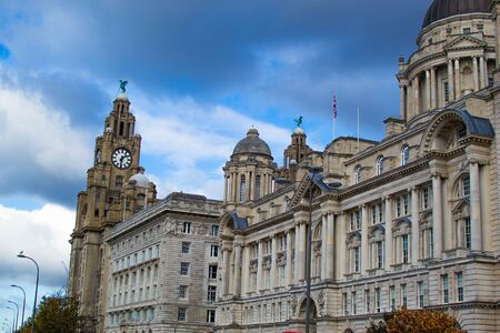 Facade of Port of Liverpool Building (or Dock Office) with the tower of the Royal Liver Building at the background in Pier Head, along the Liverpool's waterfront, England, United Kingdom