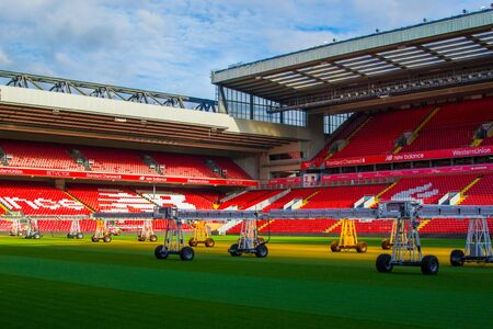 Liverpool, England, United Kingdom; 10/15/2018: Empty red steps or terraces of Anfield, Liverpool's FC Stadium, during a tour