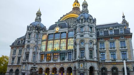 Antwerp, Belgium; 10/25/2019: Facade of Antwerp Central (Antwerpen Centraal), the main train station during the evening