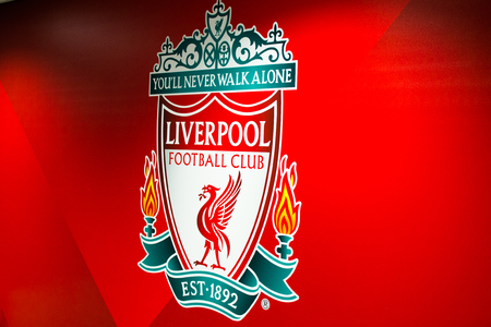 Liverpool, England, United Kingdom; 10152018: Liverpools FC badge or emblem with red background inside of Anfield Stadium Editorial